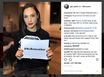 Gal Gadot avec l'affichette #WeRemember qui lui a valu nombre de commentaires haineux (photo : capture d'écran Gal Gadot Instagram)